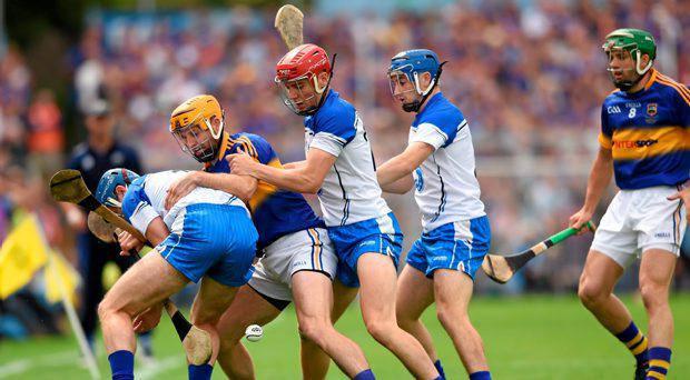 Waterford players, from left, Michael Walsh, Eddie Barrett and Colin Dunford in action against Tipperary's Kieran Bergin and James Woodlock, right