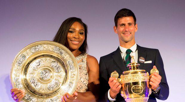 Handout picture from the AELTC of Serbia's Novak Djokovic and USA's Serena Williams on stage with their trophies at the Wimbledon Champions Dinner at the Guildhall, London