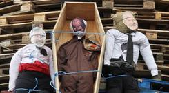 Bobby Sands, Gerry Adams and Martin McGuinness at a July 11 bonfire in a Ballycraigy estate, Antrim