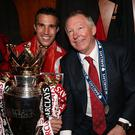 Alex Ferguson sits with Robin van Persie after Manchester United's sealed the title in 2013