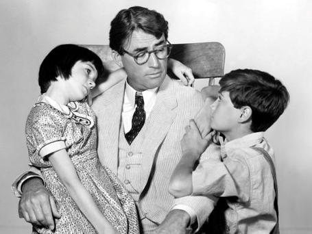 Cultural legacy: Gregory Peck as Atticus Finch with Mary Badham as Scout and Phillip Alford as Jem in the 1962 film adaptation of 'To Kill a Mockingbird', based on Harper Lee's 1960 novel.