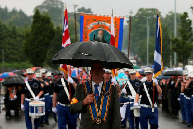 An Orange Order parade on Crumlin Road, Belfast, adjacent to the nationalist Ardoyne neighbourhood as part of the annual Twelfth of July celebrations, marking the victory of King William III's victory over James II at the Battle of the Boyne in 1690 Credit: Brian Lawless/PA Wire