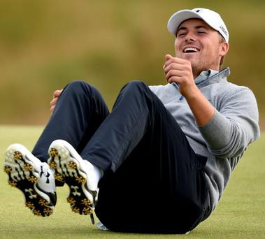 Jordan Spieth of the United States falls over laughing as he plays a practice round at St Andrews