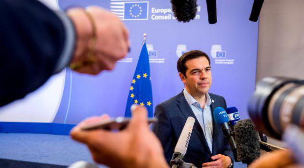 Greek Prime Minister Alexis Tsipras speaks with the media after a meeting of eurozone heads of state at the EU Council building in Brussels on Monday, July 13, 2015