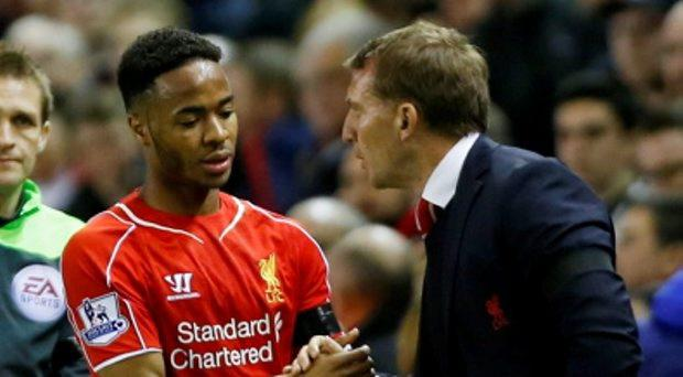 Liverpool's Raheem Sterling shakes hands with manager Brendan Rodgers