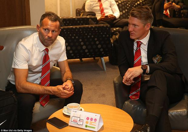 United assistant boss Ryan Giggs (left) has a conversation with Bastian Schweinsteiger