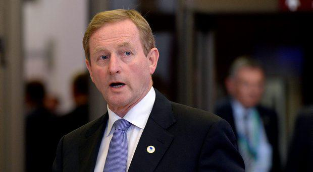 Enda Kenny leaves at the end of an EU summit on the Greek debt crisis at the EU Council in Brussels on July 13, 2015