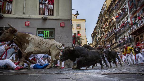 At least four tourists have been 'seriously hurt' during this year's famous San Fermin festival in Pamplona, Spain (AP)