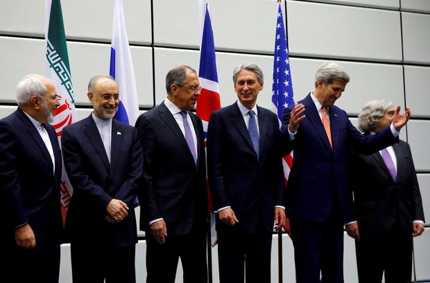 Iranian Foreign Minister Mohammad Javad Zarif, Head of the Iranian Atomic Energy Organization Ali Akbar Salehi, Russian Foreign Minister Sergey Lavrov, British Foreign Secretary Philip Hammon, U.S. Secretary of State John Kerry and U.S. Secretary of Energy Ernest Moniz (L to R) react as they pose for a group picture at the United Nations building in Vienna, Austria July 14, 2015. Iran and six major world powers reached a nuclear deal on Tuesday, capping more than a decade of on-off negotiations with an agreement that could potentially transform the Middle East, and which Israel called an