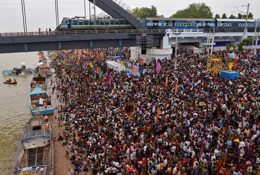 Devotees crowd attend the Maha Pushkaralu festival on the banks of river Godavari in India Credit: R Narendra