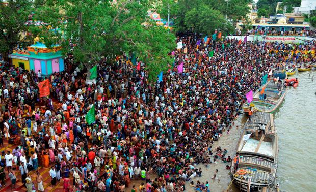 Indian devotees gather on the banks of the Godavari river Credit: Strstrdel (Getty Images)