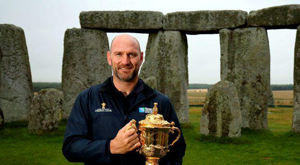 Former England Rugby International and Rugby World Cup 2003 winner Lawrence Dallaglio holds the Webb Ellis Cup at Stonehenge, Wiltshire, on day 34 of the 100 day Rugby World Cup Trophy Tour of the UK & Ireland