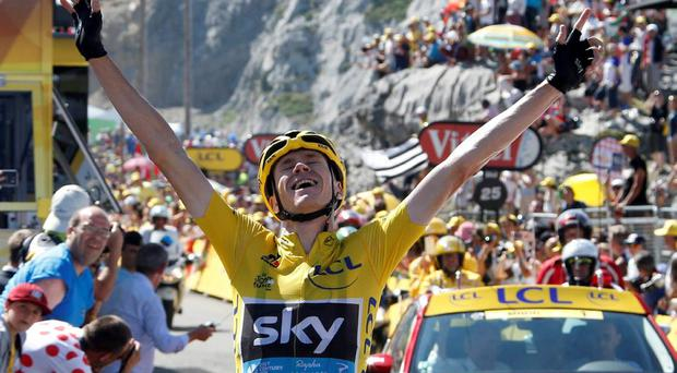 Team Sky rider Chris Froome of Britain, race leader's yellow jersey, celebrates as he crosses the finish line to win the 167-km (103.7 miles) 10th stage of the 102nd Tour de France cycling race from Tarbes to La Pierre-Saint -Martin