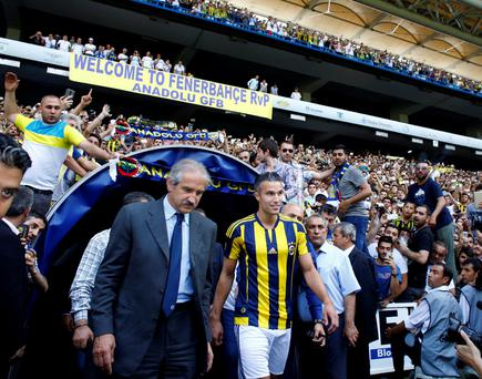 Netherlands striker Robin van Persie walks during his contract-signing ceremony with Turkish club Fenerbahce at Sukru Saracoglu Stadium in Istanbul, Turkey, July 14, 2015. REUTERS/Osman Orsal