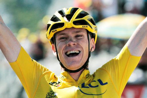 Britain's Christopher Froome, wearing the overall leader's yellow jersey, celebrates as he crosses the finish line to win the tenth stage of the Tour de France cycling race over 167 kilometers (103.8 miles) with start in Tarbes and finish in La Pierre-Saint-Martin, France, Tuesday, July 14, 2015. (AP Photo/Christophe Ena)