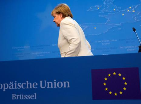 German Chancellor Angela Merkel leaves a news conference at the end of a eurozone leaders summit in Brussels on Monday. Photo: Reuters/Philippe Wojazer