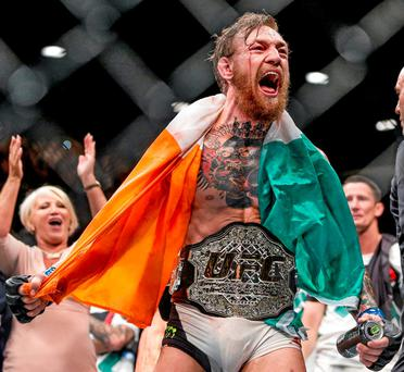 Conor McGregor celebrates after beating Chad Mendes in Las Vegas on Saturday night. Photo: Esther Lin