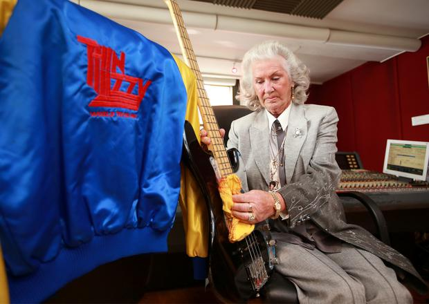 Philomena Lynott, mother of late rock star Phil Lynott, polishes his black bass guitar at the Irish Rock 'N' Roll Museum at The Button Factory in Dublin's Temple Bar. Photo: Frank McGrath