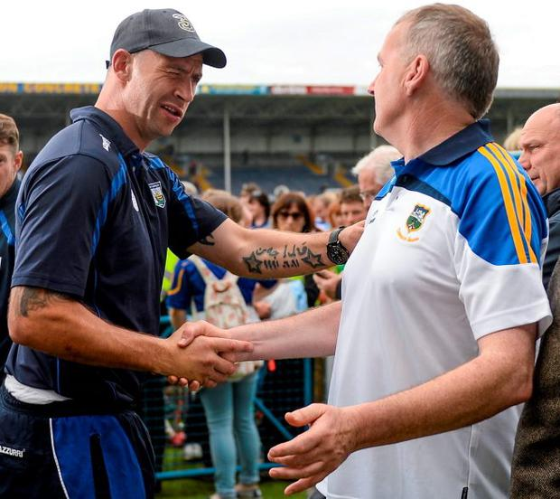 Waterford selector Dan Shanahan shakes hands with Tipperary manager Eamon O'Shea after the Munster SHC final SPORTSFILE