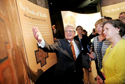 German President Joachim Gauck with Ms Daniela Schadt and TCD librarian Helen Shenton (right) at the Book of Kells Exhibition in Trinity College, Dublin