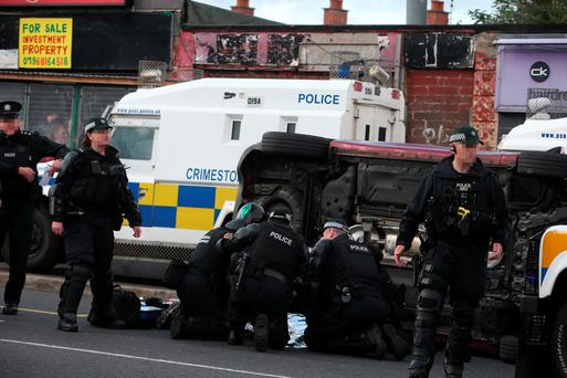 Man has been arrested for attempted murder after a teenager was hit by a car during a riot in Belfast Credit: Brian Lawless/PA Wire