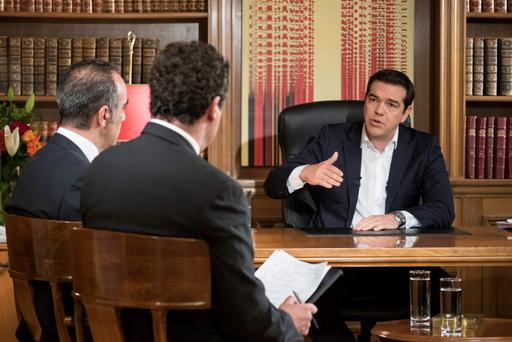 Greek Prime Minister Alexis Tsipras speaks to journalists of the Greek state broadcaster ERT during an interview at his office at the Maximos Mansion. Photo: Reuters