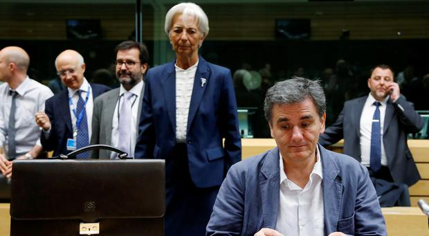 Greek Finance Minister Euclid Tsakalotos and International Monetary Fund (IMF) Managing Director Christine Lagarde (back C) attend an euro zone finance ministers meeting in Brussels earlier this week. Photo: REUTERS/Francois Lenoir