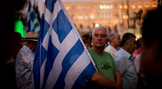 Demonstrators gather near the Greek Parliament during a rally against the government's agreement with its creditors in Athens, in central Athens. Photo: AP Photo/Emilio Morenatti