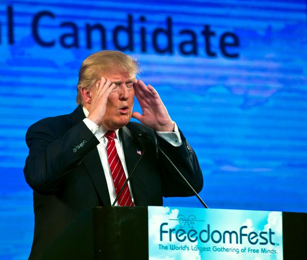 Republican Presidential candidate Donald Trump gestures as he speaks at the 2015 FreedomFest in Las Vegas