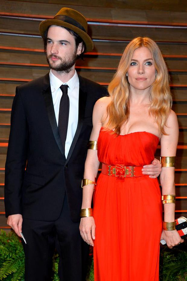 Actors Tom Sturridge (L) and Sienna Miller attend the 2014 Vanity Fair Oscar Party hosted by Graydon Carter on March 2, 2014 in West Hollywood, California. (Photo by Pascal Le Segretain/Getty Images)