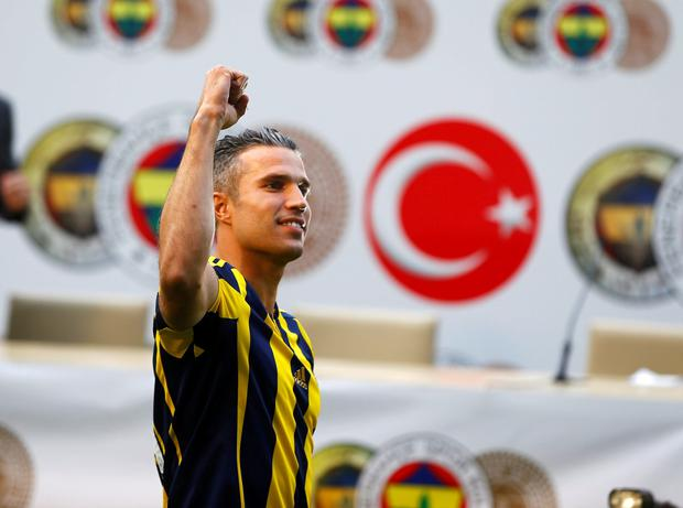 Netherlands striker Robin van Persie greets supporters during his contract-signing ceremony with Turkish club Fenerbahce at Sukru Saracoglu Stadium in Istanbul, Turkey, July 14, 2015