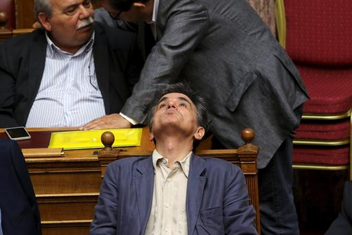 Greek Finance Minister Euclid Tsakalotos reacts during a parliamentary session in Athens, Greece July 15, 2015. A lot of the measures in a deal struck with Greece's lenders will have a recessionary effect but removing the prospect of a