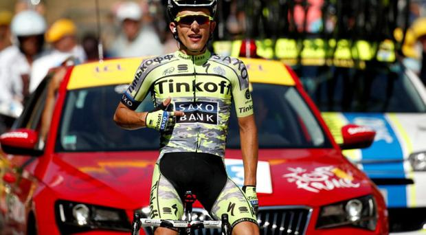 Tinkoff-Saxo rider Rafal Majka of Poland celebrates as he crosses the finish line to win the 188-km (116.8 miles) 11th stage of the 102nd Tour de France cycling race from Pau to Cauterets in the French Pyrenees