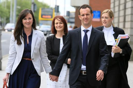 Erik and Deborah Field, parents of Ella Field who was the subject of a Civil Court action - pictured leaving court with their legal team Fiona Gallagher B.L (Background Right of pic) and Solicitor, Caoimhe Haughey (Background Left).Pic: Courts Collins