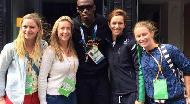 Caroline O'Hanlon (Armagh ladies football star), second right, with Northern Ireland netball team mates and Usain Bolt at the 2014 Commonwealth Games
