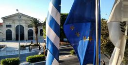 The flags of Greece and the EU flutter over the central market in the city of Chania, Cretetax