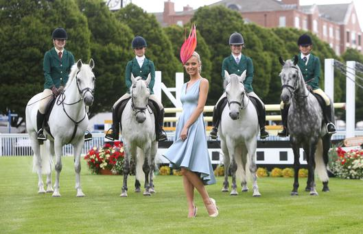 Model Gracie O'Mahony from Bennetsbridge, Co Kilkenny, with (from left to right) Lydia Dawson on Gloster Boy, Emily McQuade on Twilight Oscar, Antonia De Burgh on Rocky Cashal and Alicia Devlin Byrne on Grey Smoke at the launch of the Dublin Horse Show yesterday. Photo: Damien Eagers