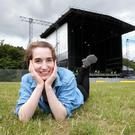 Kirsty Blake Knox lies on the grass in front of the stage at Marlay Park