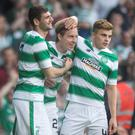 Celtic's Stefan Johansen (centre) celebrates scoring his side's second goal with Nadir Ciftci (left) and James Forrest during the UEFA Champions League Second Qualifying Round, First Leg, at Celtic Park