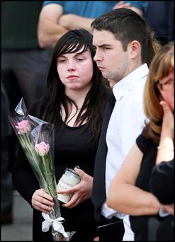 Jamie Kelly (Angela's nephew) who survived the crash; and Angela's daughter Shannon leaving the Church of the Holy Trinity in Rathdowney