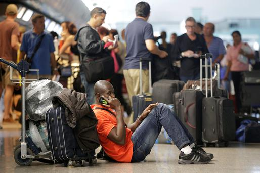 People wait at Fiumicino international airport in Rome. One of the 10 biggest cities in Europe, with a population of 2.8 million, Rome boasts some of the most spectacular squares, fountains, museums and churches in the world. Photo: Reuters