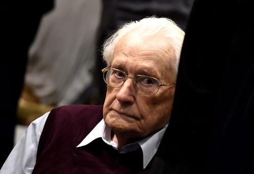 94-year-old former SS sergeant Oskar Groening listens to the verdict of his trial. Photo: AP