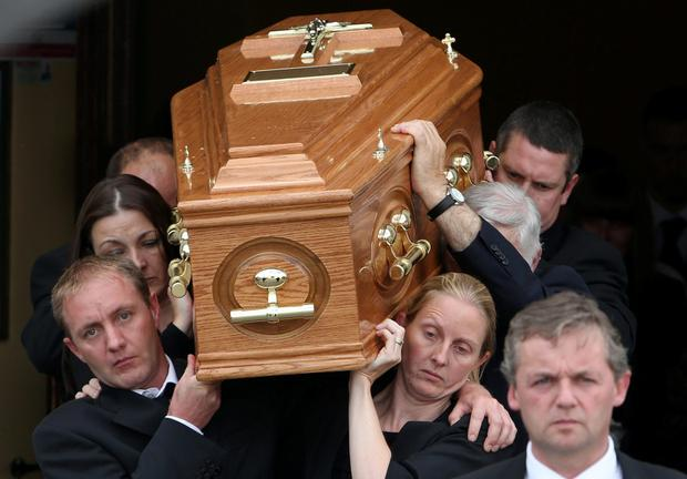 The remains are carried from church by Angela Kelly's twin sister, Amanda (front right) and other family members at the funeral of Angela Kelly who was one of three people killed in a car crash last Sunday at Middlemount on the R433 Rathdowney to Abbeyleix Road
