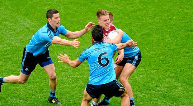 12 July 2015; Paddy Holloway, Westmeath, in action against Dublin players, left to right, Rory O'Carroll, Cian O'Sullivan, and John Cooper. Leinster GAA Football Senior Championship Final, Westmeath v Dublin, Croke Park, Dublin. Picture credit: D?ire Brennan / SPORTSFILE