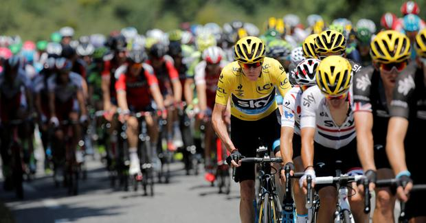 Britain's Christopher Froome, wearing the overall leader's yellow jersey, rides in the pack during the eleventh stage of the Tour de France cycling race over 188 kilometers (116.8 miles) with start in Pau and finish in Cauterets, France, Wednesday, July 15, 2015. (AP Photo/Laurent Cipriani)