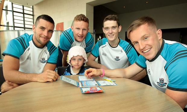 Kevin O Brien,Ciaran Kilkenny,Brian Fenton and Philly Ryan from the Dublin Senior GAA Football panel were on hand to share their footballing tips with budding local Docklands GAA fans and players and one very special little Dubs fan, Molly McNally (centre) at a charity meet and greet at the Gibson hotel