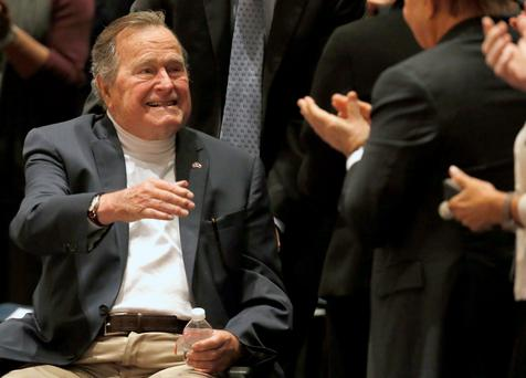 Former President George H.W. Bush acknowledges the crowd at his presidential library