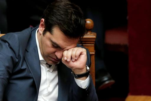 Greek Prime Minister Alexis Tsipras reacts during a parliamentary session in Athens, Greece July 16, 2015. The Greek parliament passed a sweeping package of austerity measures demanded by European partners as the price for opening talks on a multi-billion euro bailout package needed to keep the near-bankrupt country in the euro zone. REUTERS/Alkis Konstantinidis TPX IMAGES OF THE DAY