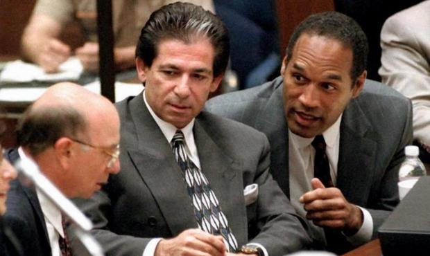 Robert Kardashian and OJ Simpson pictured at his murder trial