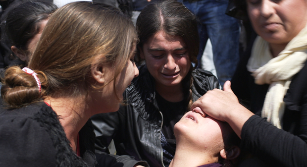A young Yazidi woman suffers a post traumatic collapse during a protest in a camp for displaced people, northern Iraq. Photo: Dispatches/ Channel 4